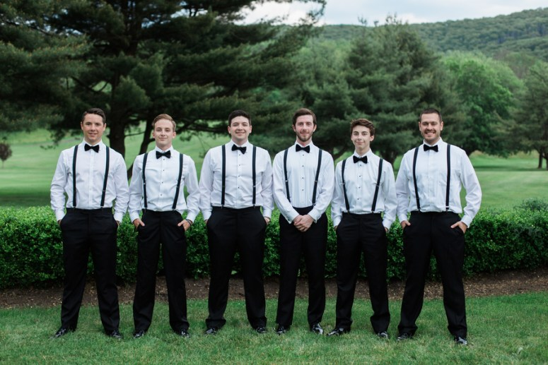 groom and groomsmen wearing bow tie and suspenders