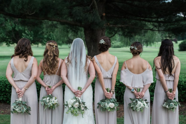 bridesmaids with different style dresses