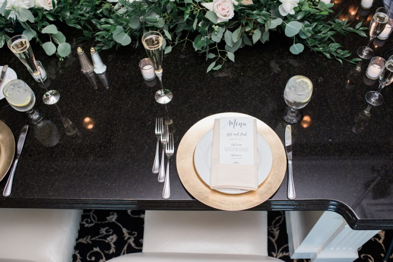 gold and green wedding table setting