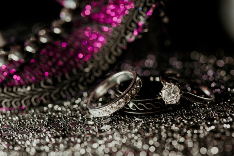 wedding rings photo shoot on masquerade mask