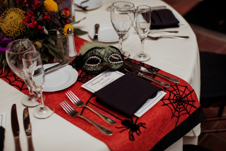 halloween themed table runner at wedding reception
