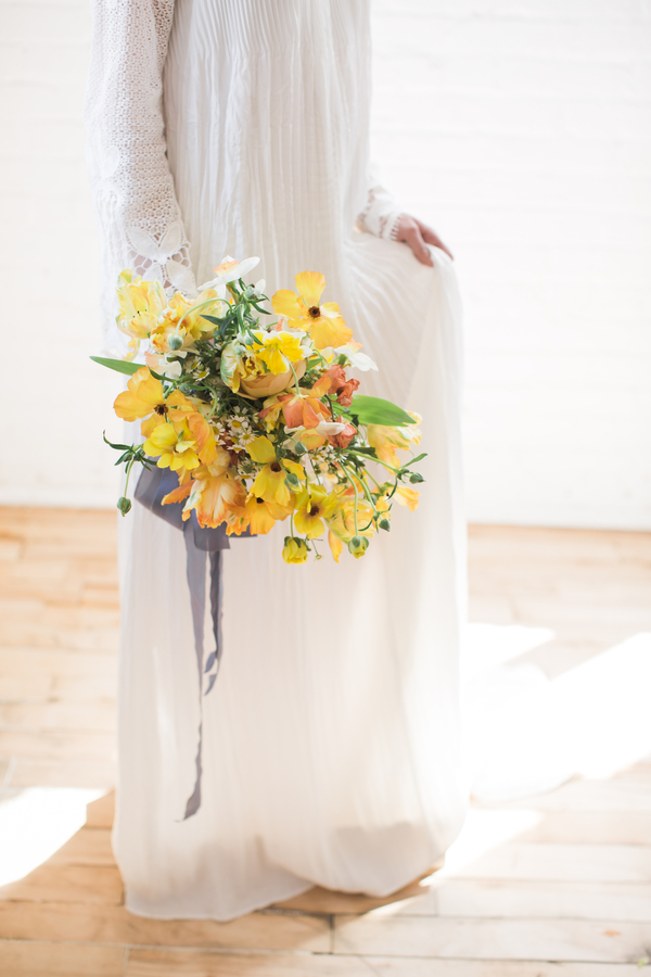 yellow wedding bouquet tied with silk ribbon