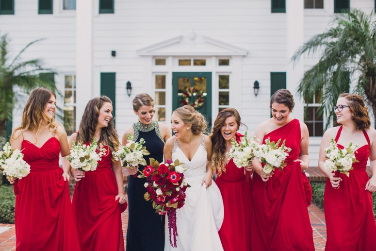 brides maids wearing long red gowns