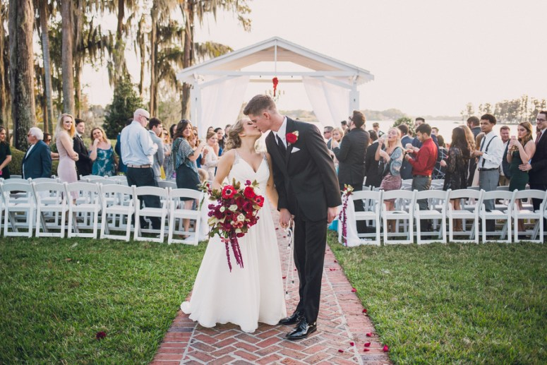 bride and groom first kiss after vows
