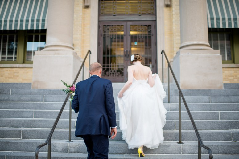 Bride and Groom walking to courthouse