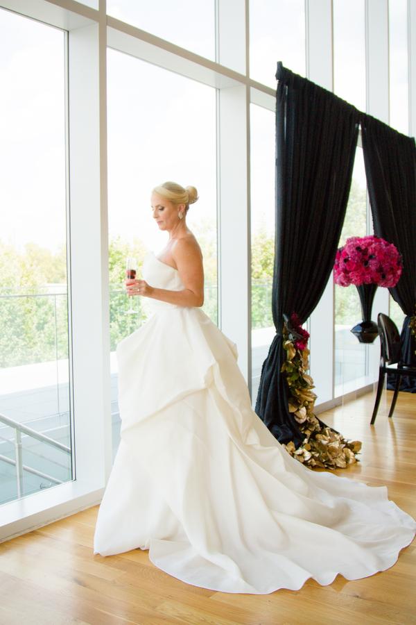 hot pink wedding, pink and black wedding, wedding at Columbus Museum of Art, bride drinking pink champagne