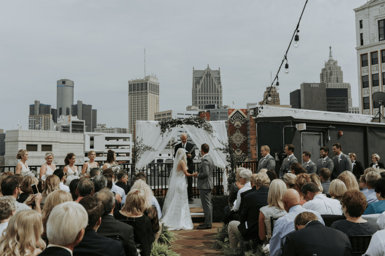 rooftop wedding, string lights at wedding, ceremony arch