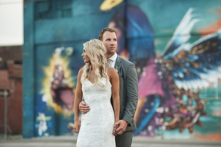Detroit wedding photographer, Detroit wedding, downtown wedding, bride and groom in front of graffiti