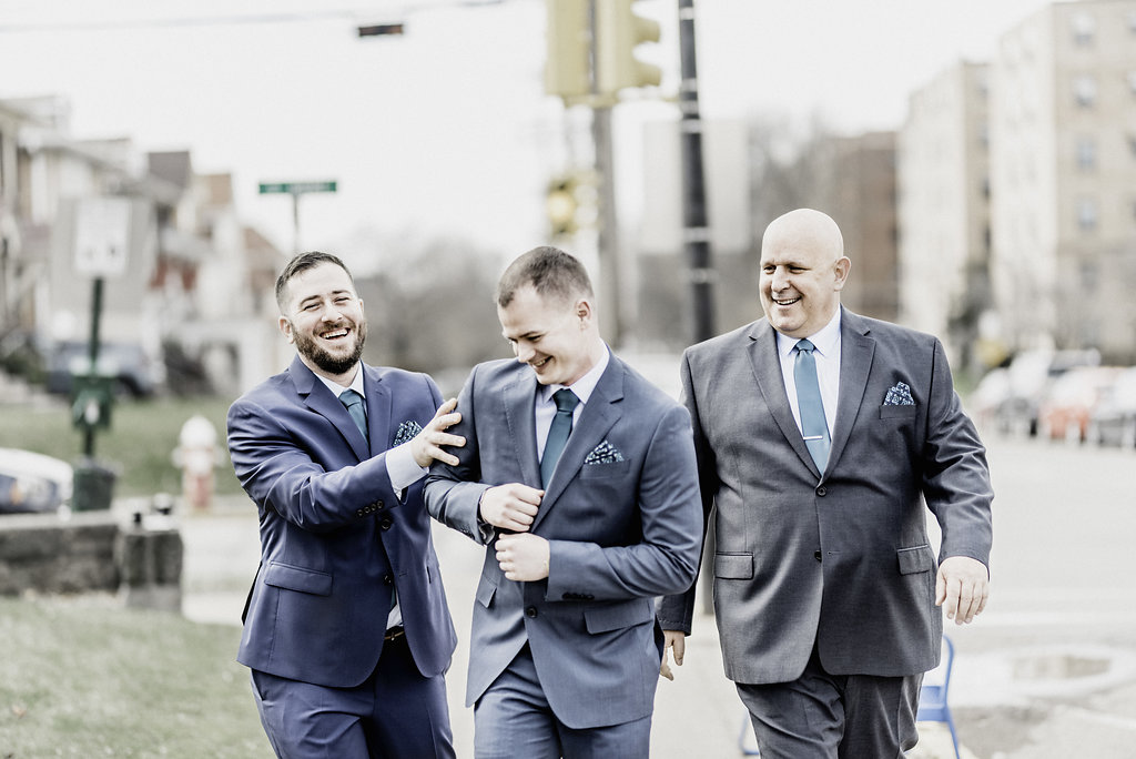 Groomsmen photo walking to ceremony