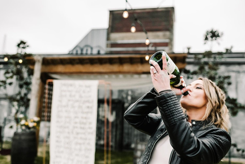 Loflin Yard Wedding, Memphis Wedding, Rock and Roll Bride, Modern Wedding, Bride drinking champagne from bottle