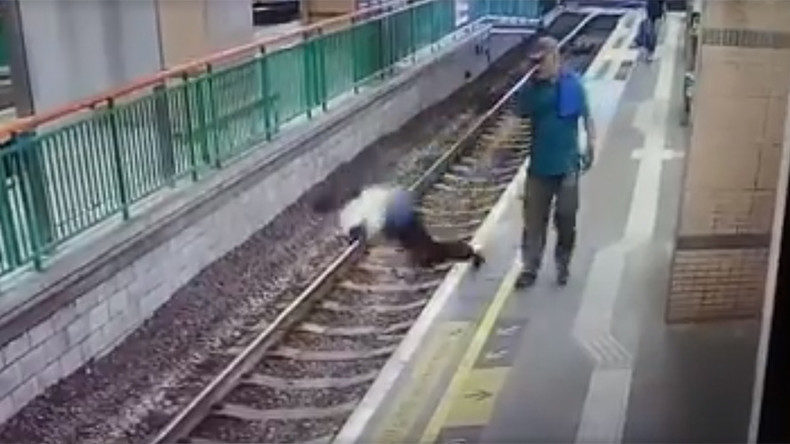 Cold blooded CCTV VIDEO captures man pushing woman on rail