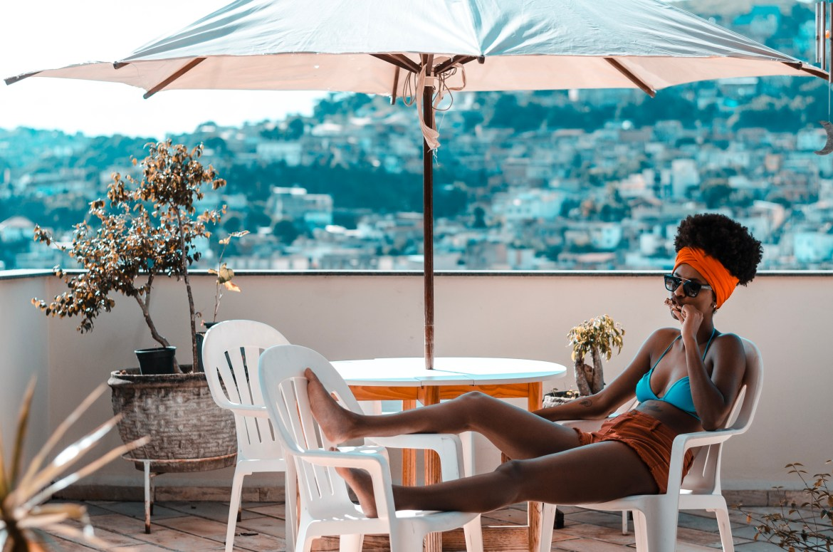 black woman relaxing on vacation