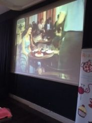 projected image of a beginning of Video about cafes