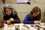 Jill and Evander crafting medicine shields