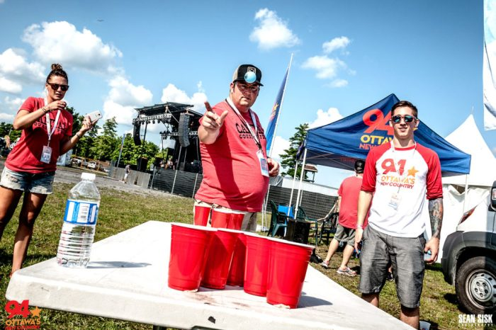 Ryan Lindsay and PJ of New Country 94 playing bean pong