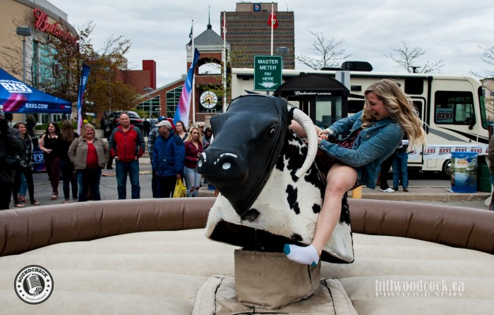 Riding the mechanical bull at the Bud Gardens Pre-Show Tailgate Party - Bill Woodcock