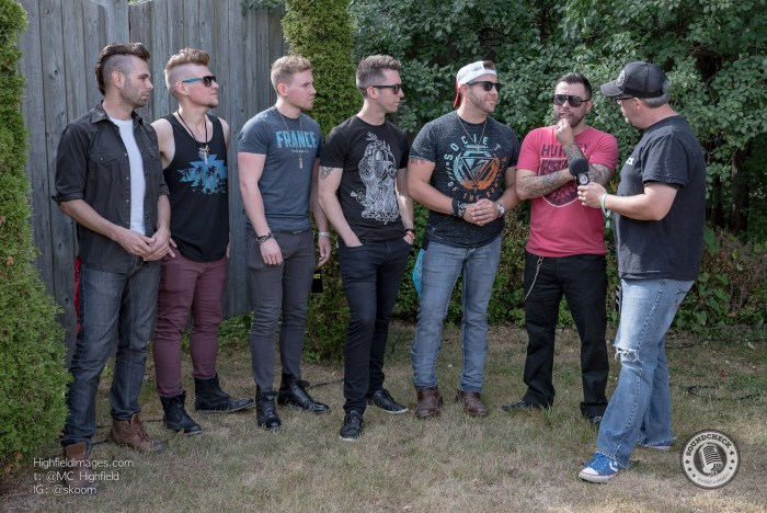 Corey chats with Cold Creek County while backstage at CMT Music Fest - Photo: Mike Highfield