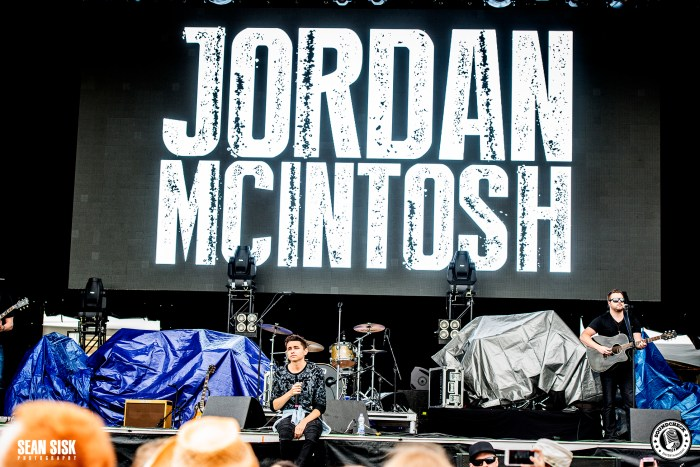 Jordan McIntosh sits on the side of the City Stage at RBC Bluesfest - photo by Sean Sisk