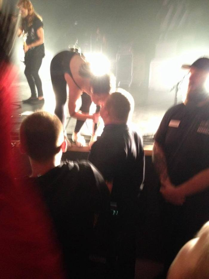 Leah kisses Leigh's hand at the July Talk Halloween show at Algonquin Commons Theatre