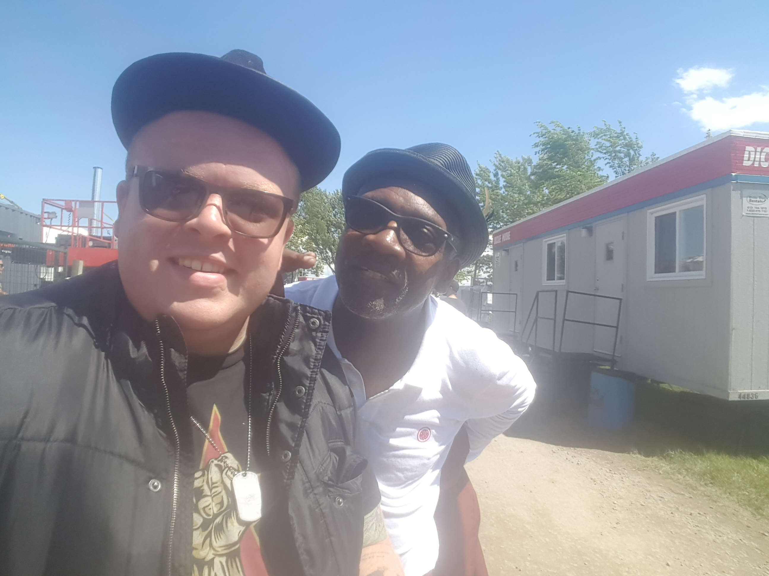 Our own Leigh Bursey posing with Lynval Golding of Lynval Golding and Contra Coup, and legendary English band, The Specials.