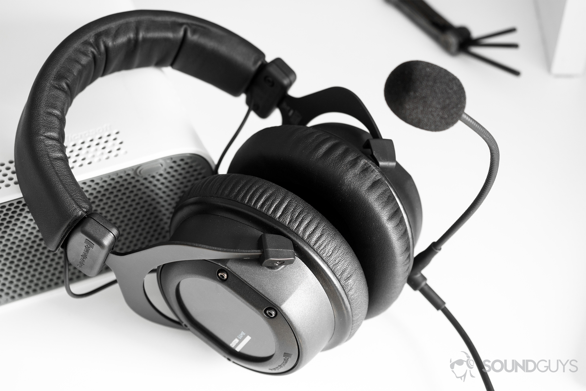 hight resolution of gaming headset beyerydynamic custom game headset leaning on a white xbox 360 with a universal