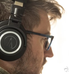 a photo of the audio technica ath m50xbt on a man s head  [ 1900 x 1267 Pixel ]