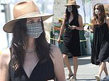 Courteney Cox shows summer style at farmer`s market...