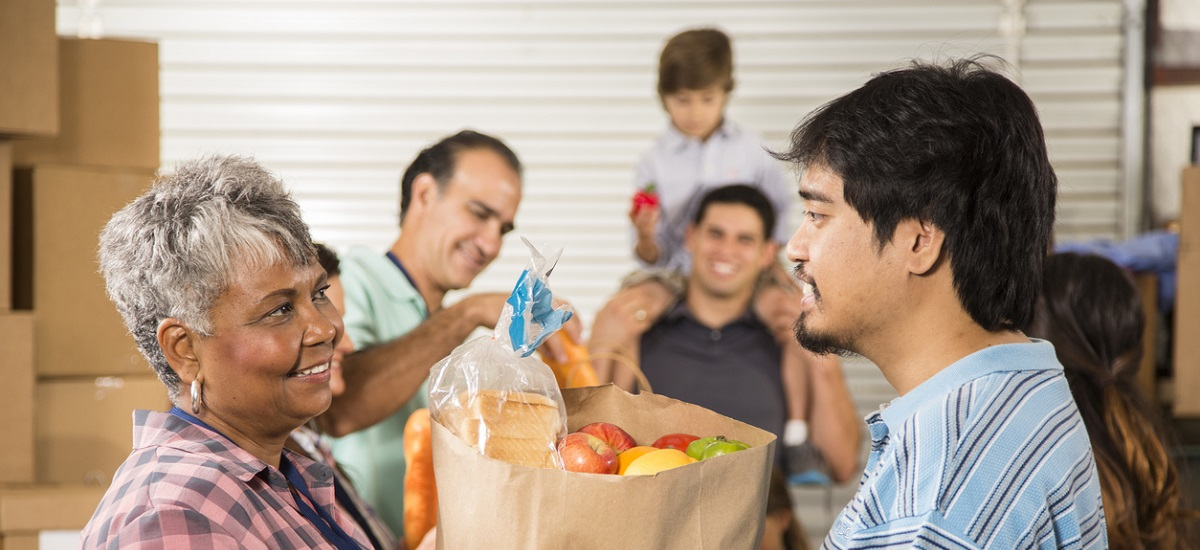 Group of volunteers provide groceries donations to needy families for charity