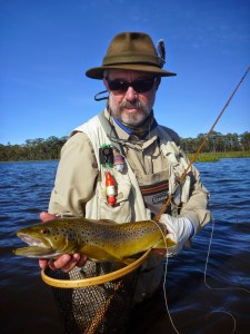 Picture of Boris with a beautiful trout caught in the Tasmanian highlands Penstock Lake.