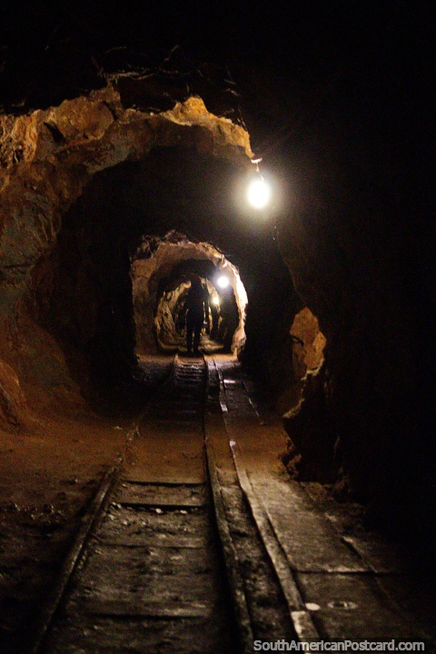 Walking 500 meters into the tunnels at El Sexmo gold mine in Zaruma. Photo from Ecuador. South America (480x720px)