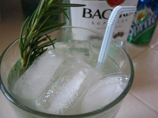 Mojito infused with rosemary simple syrup and garnished with a sprig!