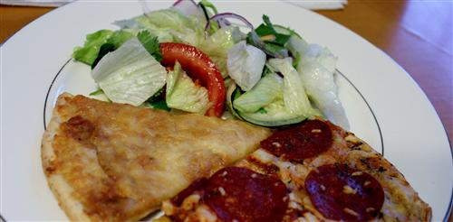 Serving a Fresh Salad with Newman's Own Four Cheese and Pepperoni Pizzas.