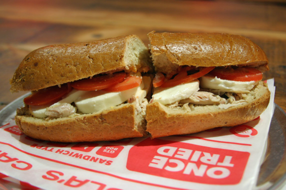 Rotisserie chicken sandwich with mozarella and roma tomatoes