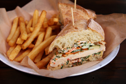 banh mi sandwich with a side a fries