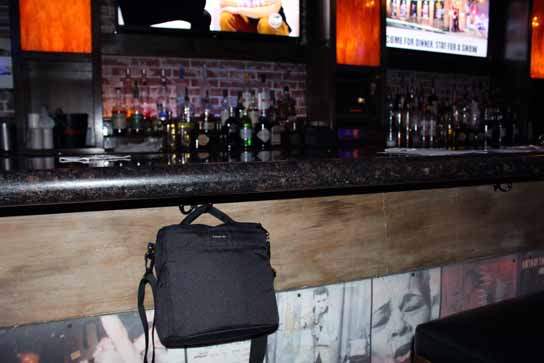 Yes!  Look for hooks under the bar for your purse, murse, or camera bag.