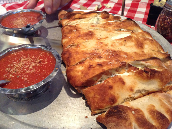 Sausage, meatball and ricotta calzone