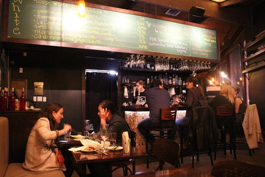 The cozy, lively scene inside Bacari PDR.