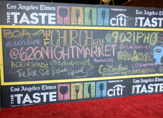 Attendees get to have fun with the chalkboard red carpet entrance