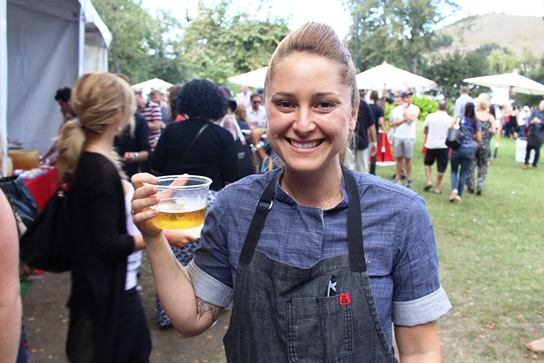 Chef Brooke Williamson cools of with a large sample of beer after heating up the demonstration stage.