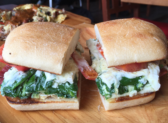 Mexican Torta with fresh spinach, tomato, egg whites and serrano ham