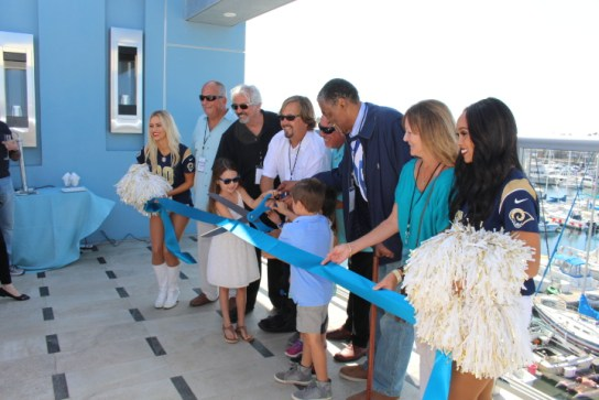 Honored guests joined the proprietor of Shade Hotels, Michael Zislis, center, in cutting the ribbon for Shade Hotel Redondo on Sunday, October 2, 2016.