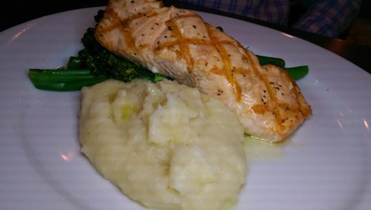 Grilled salmon on a bed of cauliflower and potato mash.
