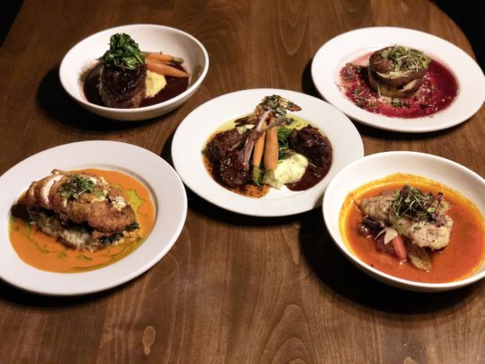 The entrees include a choice of Pan Seared Pacific Sea Bass, Braised Short Rib Osso Buco, Herbed Goat Cheese Stuffed Breast of Chicken.