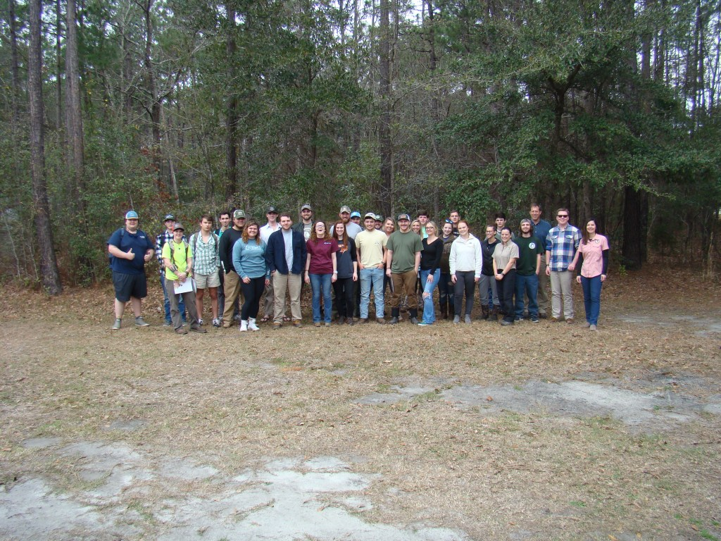 Westerhold's students and SCDNR employees stand posed for a group photo outdoors.