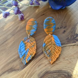 orange and bright blue leaf dangly earrings