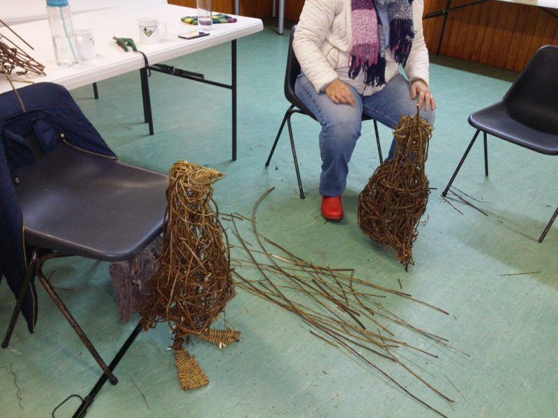 photo of students making willow penguin sculptures