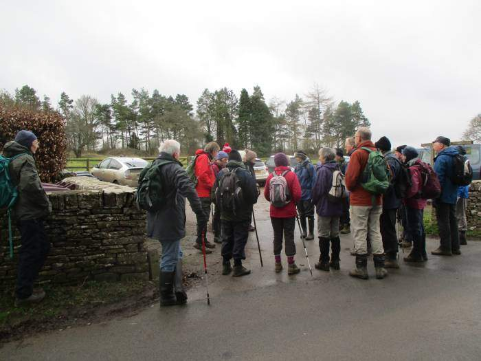 But join forces with those in the school car park. Who is wearing the red and white hat at the back?