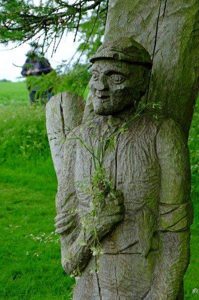 Passing a wooden carving - don't think the artist intended it to be  holding flowers