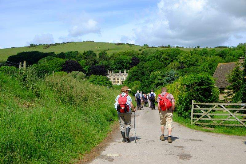 Briefly descending towards Postlip Hall