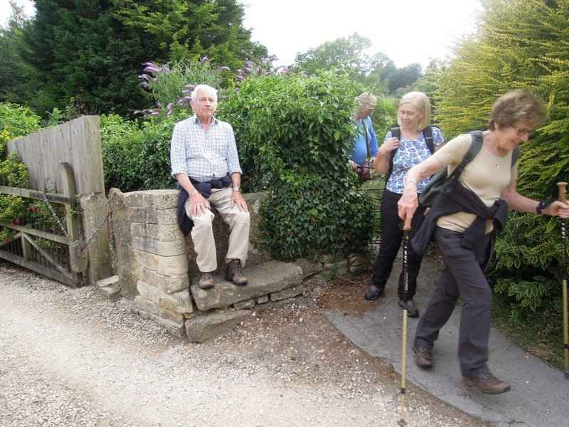 At the top Goff rests on the stone stile, while others use the kissing gate